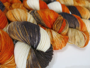 hand dyed fox coloured merino yarn skeins in russet black and white