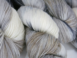 horse colored grey white and tan sock yarn skeins by my mama knits
