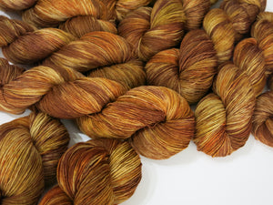 hand dyed yarn in willow basket browns and reds
