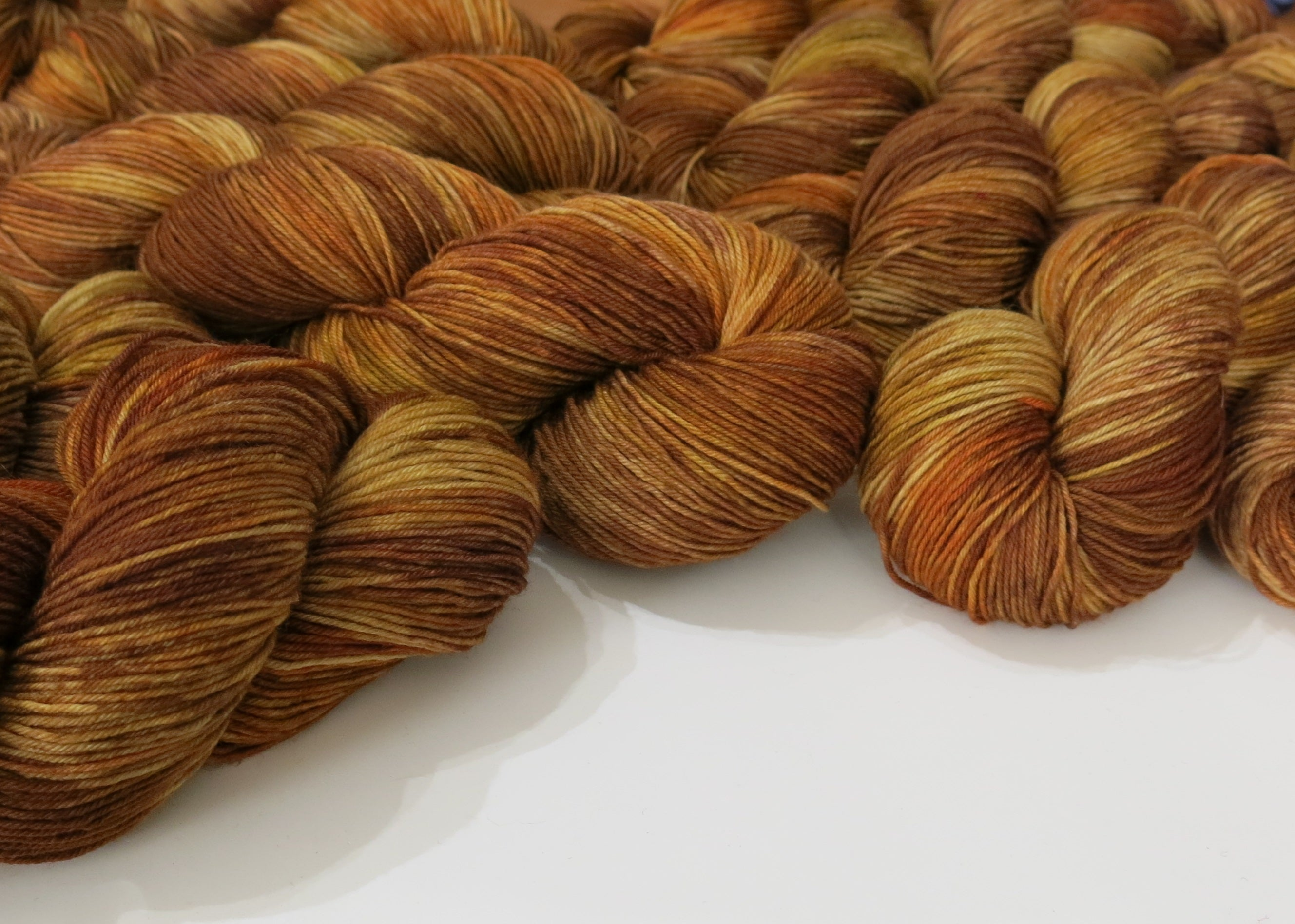 indie dyed yarn in reds, browns and yellows insoired by scottish willow back creels