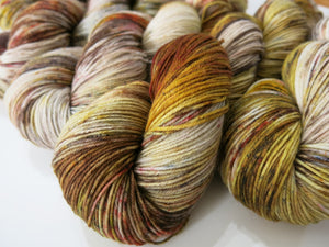 hand dyed speckled yarn skeins in browns and greys