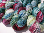speckled variegated yarn with maroons and greens