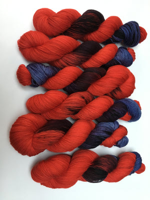 indie dyed red and purple sock yarn merino for knitting and crochet