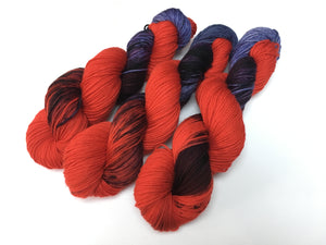 indied yed red and purple sock yarn skeins for knitting and crochet