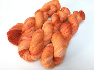 hand dyed tonal orange 100g sock yarn skeins for knitting and crochet