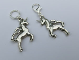 double sided silver coloured unicorn stitch marker on a lobster clasp