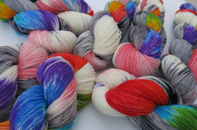 sock yarn skeins with rainbow colours and grey speckles