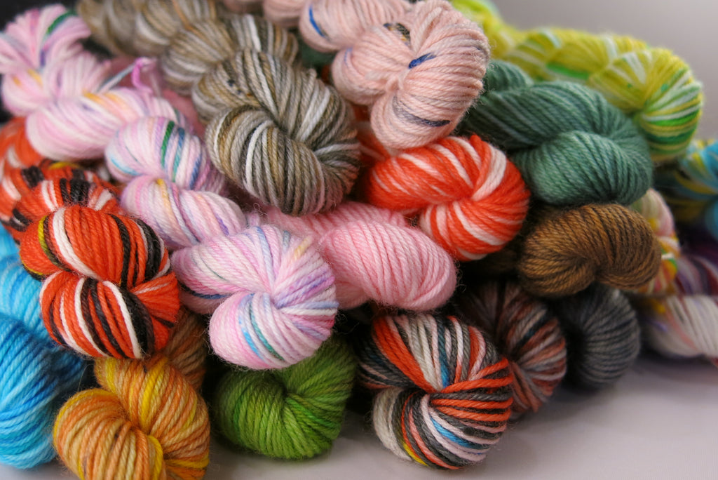 alice in wonderland hand dyed merino sock yarn mini skein set