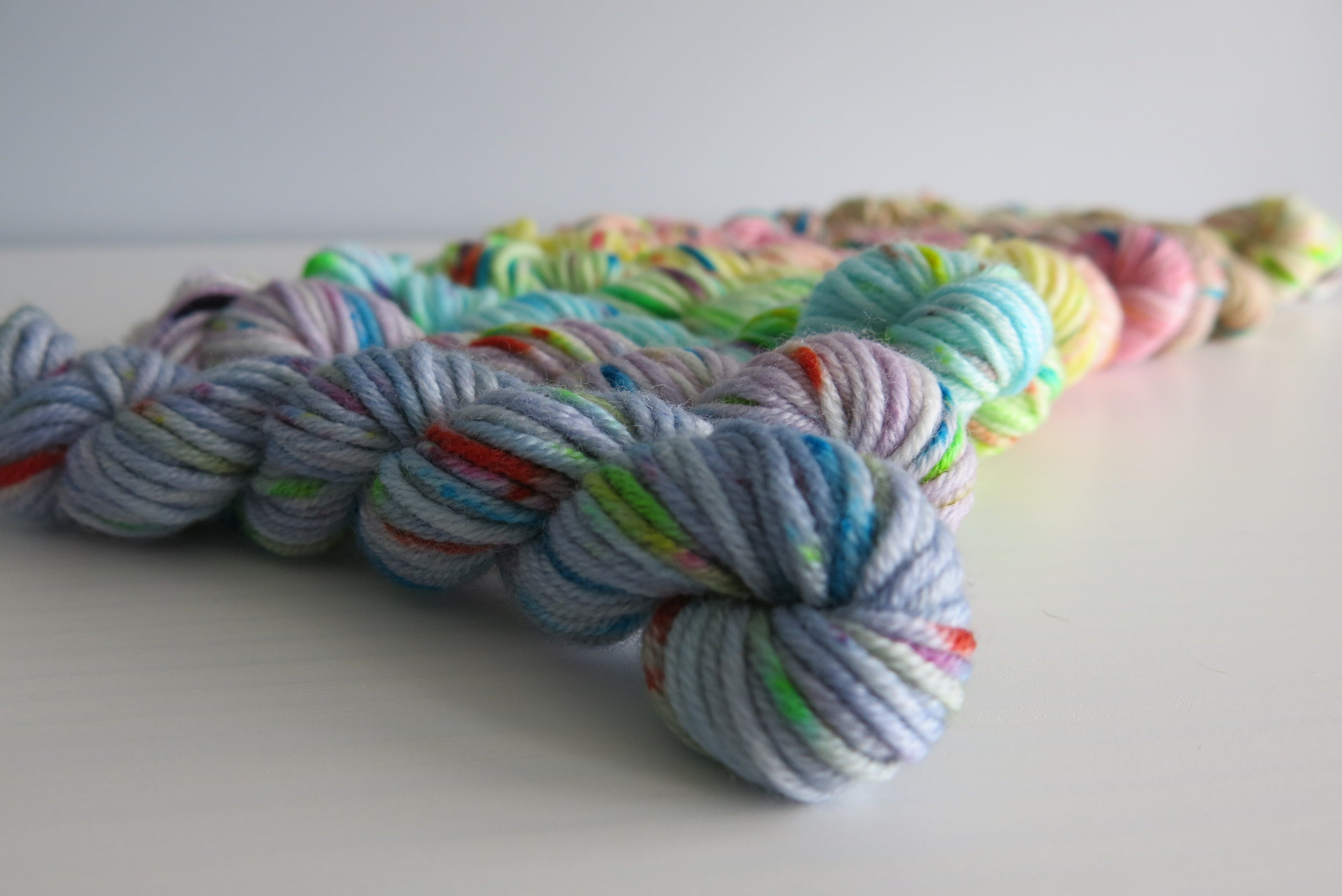 indie dyed merino dk yarn mini skeins in a pastel rainbow