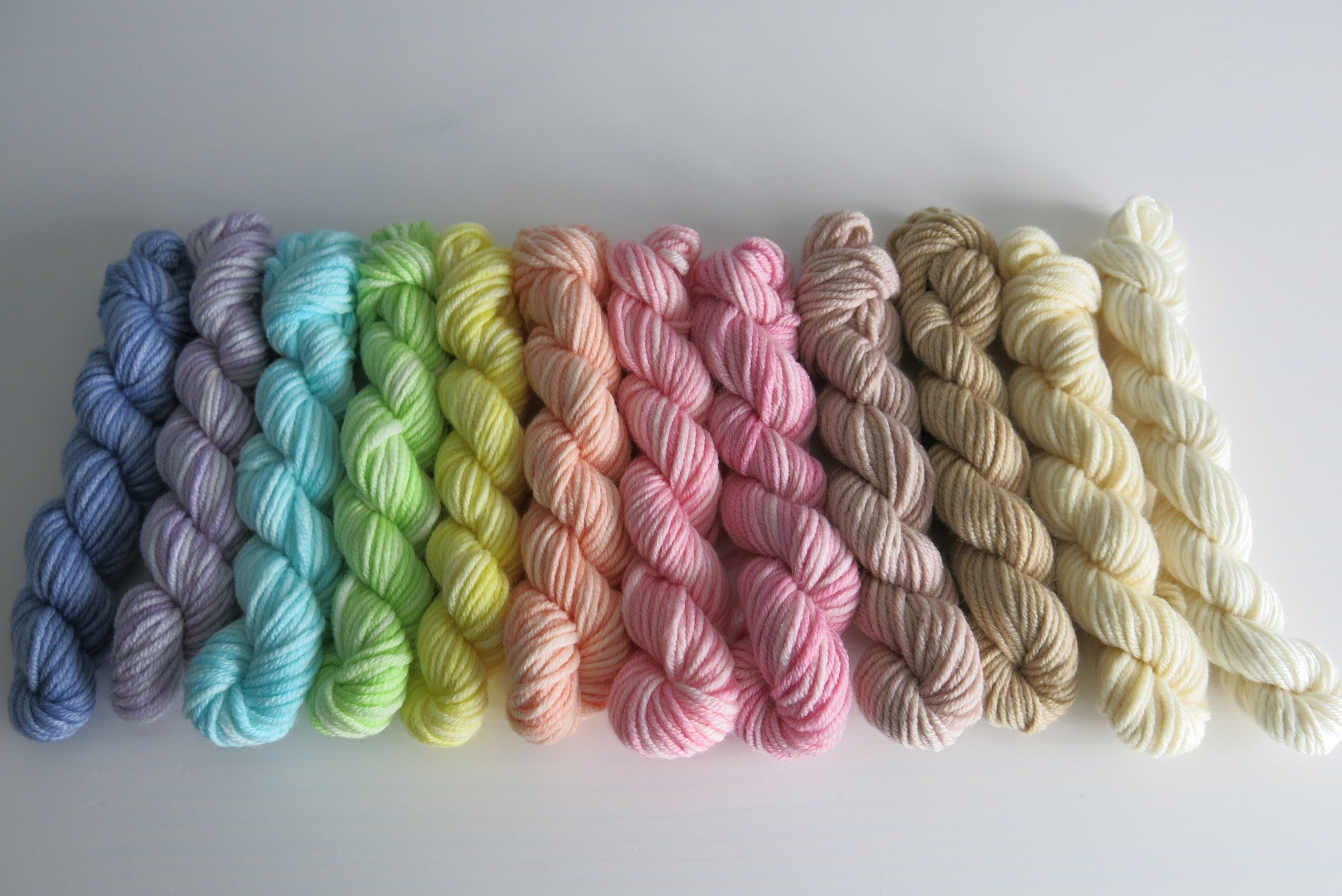 hand dyed superwash merino mini skeins in a pastel rainbow