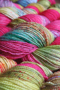 indie dyed pink and yellow speckled sock yarn