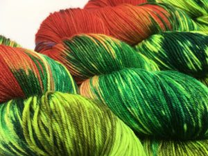 red and green hungry caterpillar merino yarn for weaving and knitting
