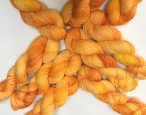kettle dyed orange and yellow yarn skeins for weaving and knitting crafts