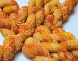 kettle dyed sun yellow superwash sock yarn for knitting and crochet