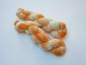 indie dyed orange and white superwash merino sock yarn