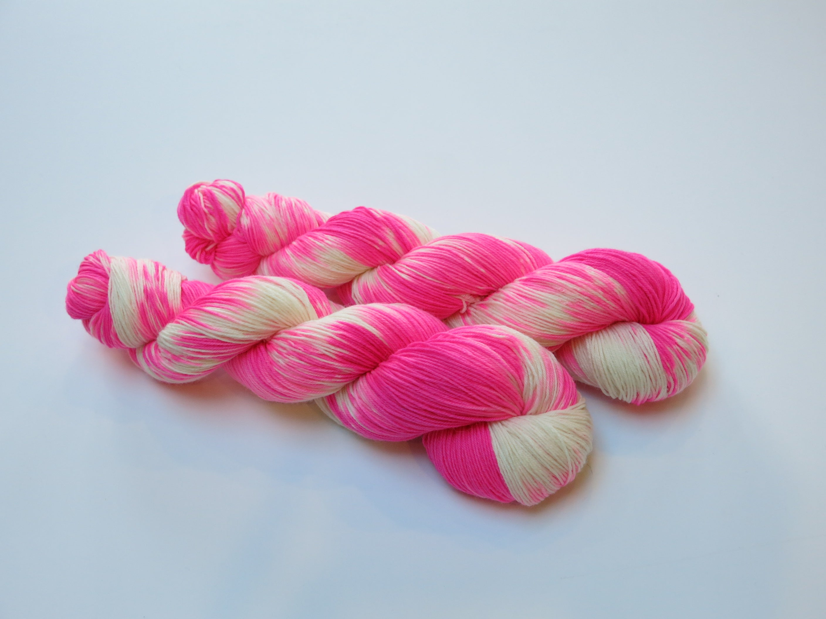 indie dyed uv reactive neon pink superwash merino sock yarn skein