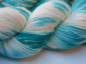 indie dyed superwash merino sock yarn in blue and white