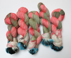 hand dyed zombie eyeball themed yarn skein