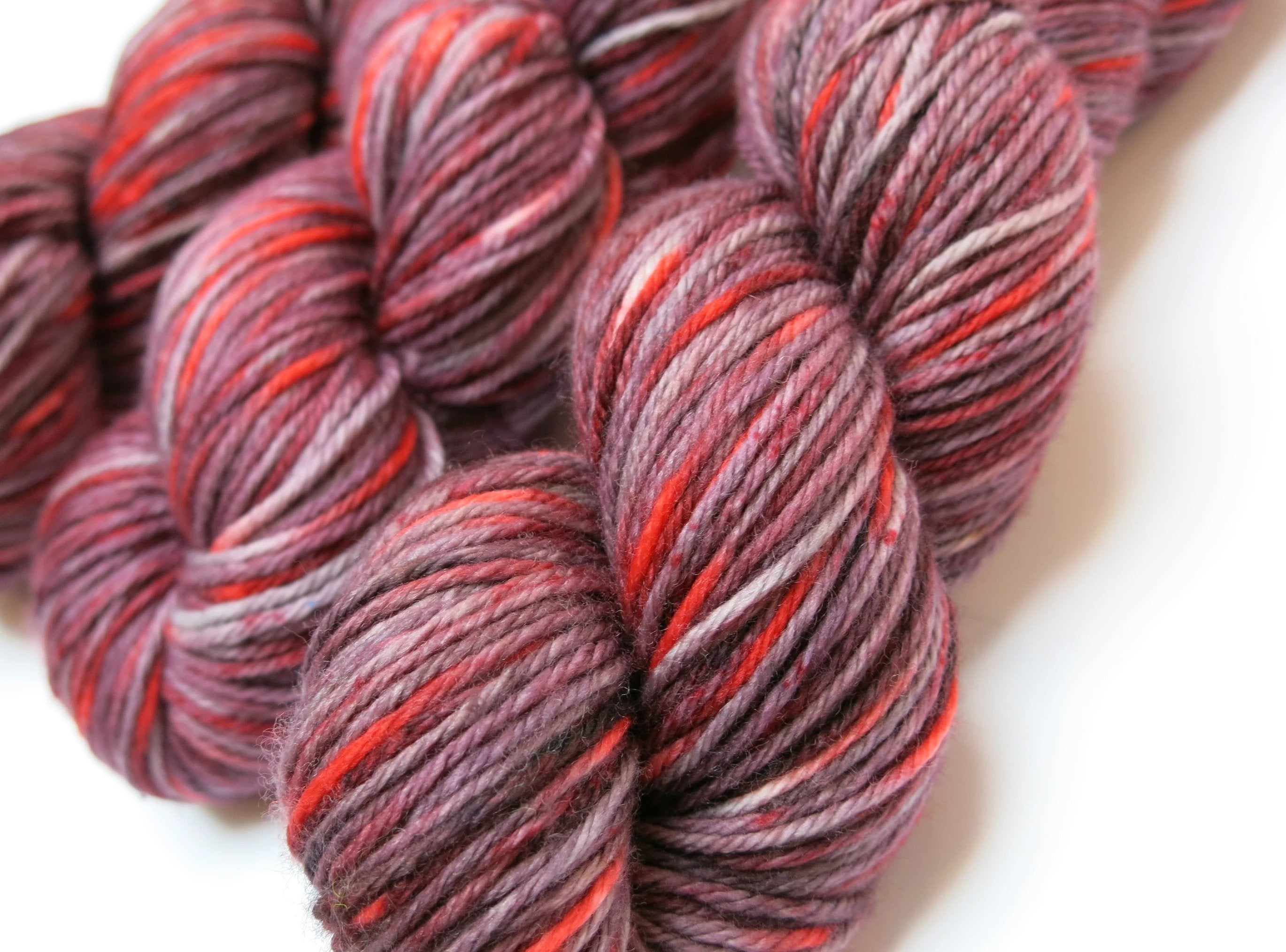 hand dyed red superwash merino yarn skeins