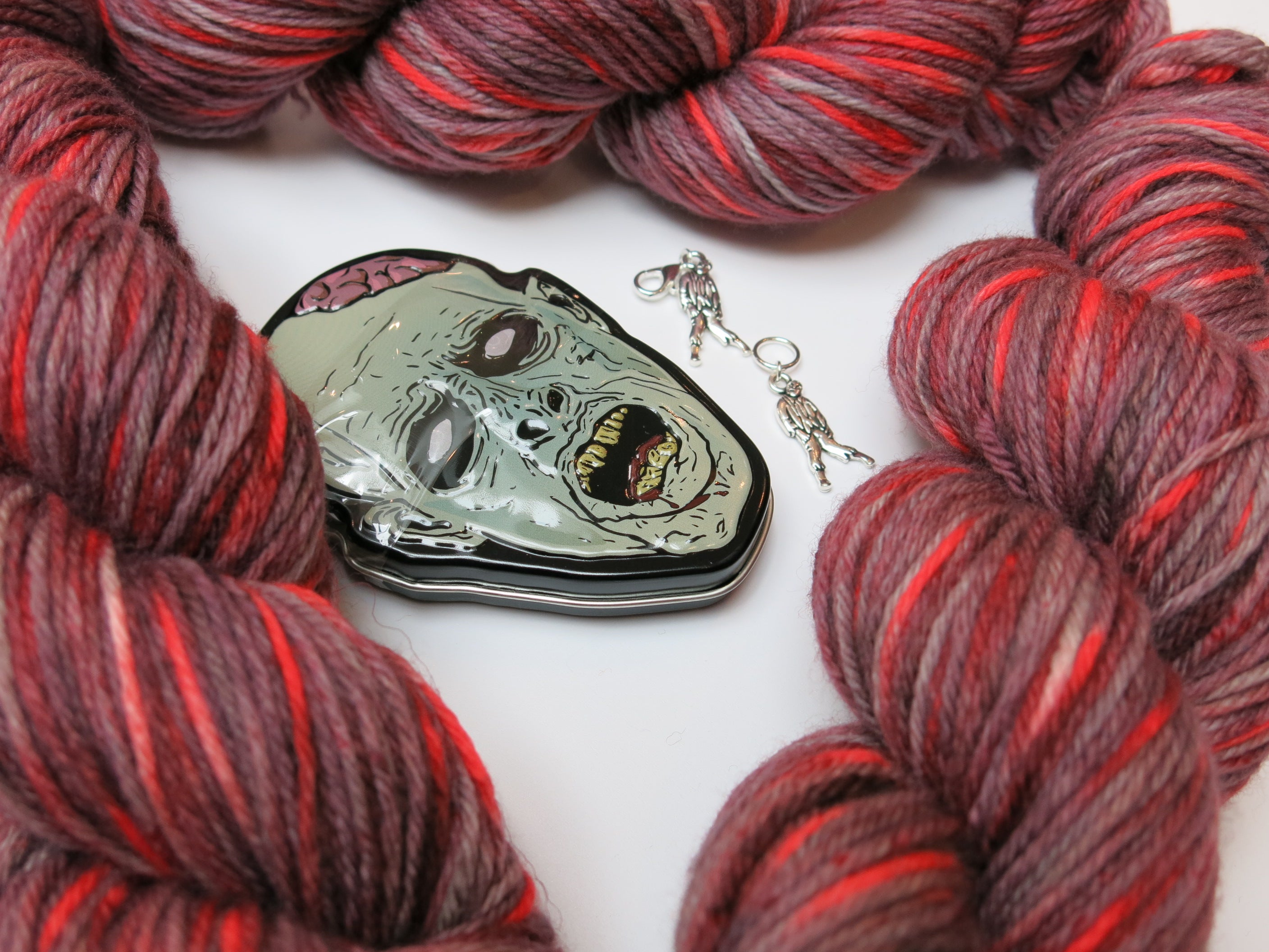 red zombie themed merino dk yarn skein and notions tin