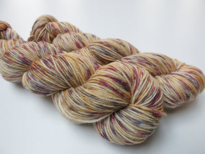 indie dyed 8 ply yarn skeins with an alice in wonderland theme