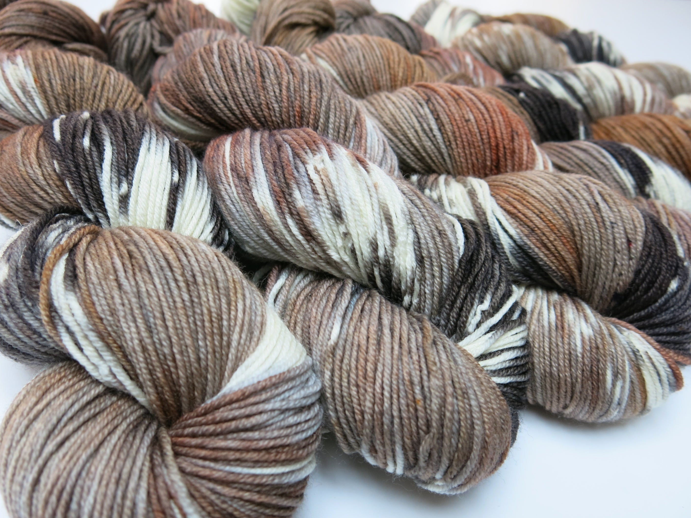 kettle dyed merino yarn skeins in the colors of a hare