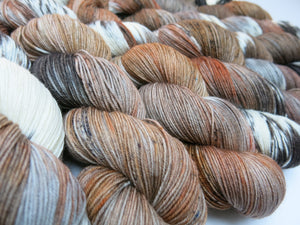 alice in wonderland themed merino sock yarn skeins
