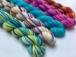 alice in wonderland inspired merino sock yarn mini skeins