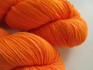 hand dyed black light orange wool by indie dyer my mama knits
