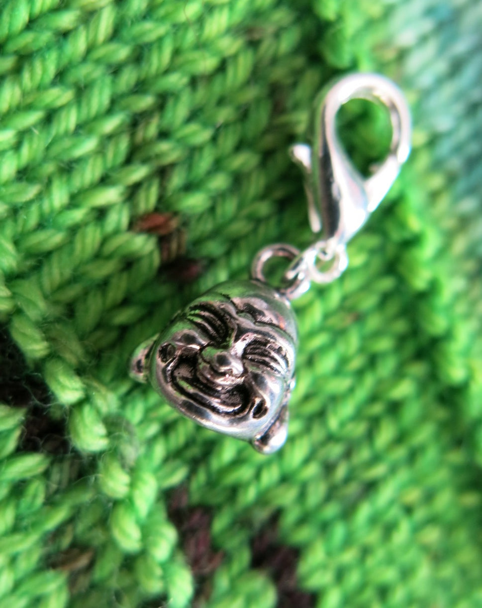 smiling buddha charm on a clasp for crochet, zippers, and friendship bracelets