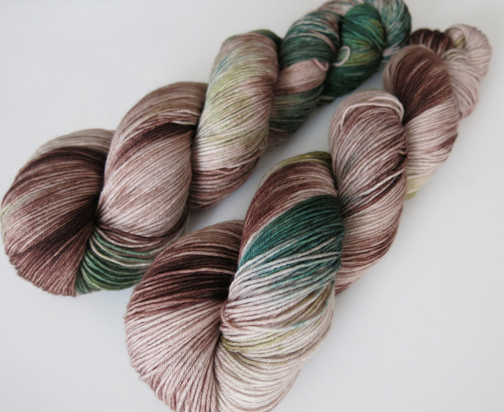 kettle dyed brown and green merino sock yarn skeins for knitting
