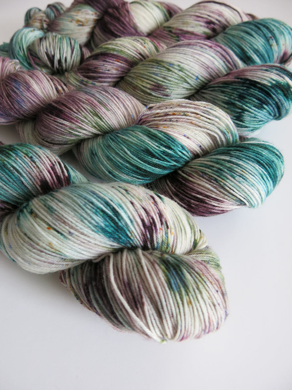 brown and green speckled yarn skeins for knitting or crochet