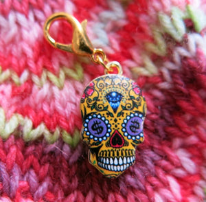 yellow dollar sign sugar skull charm for place keeping in crochet