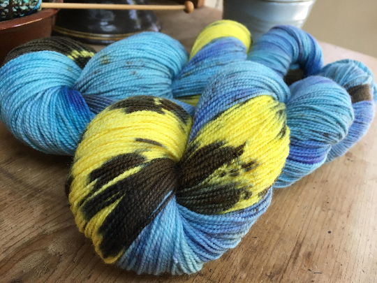 indie dyed blue and yellow merino sock yarn skeins
