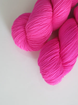 neon pink yarn skein for knitting and crochet