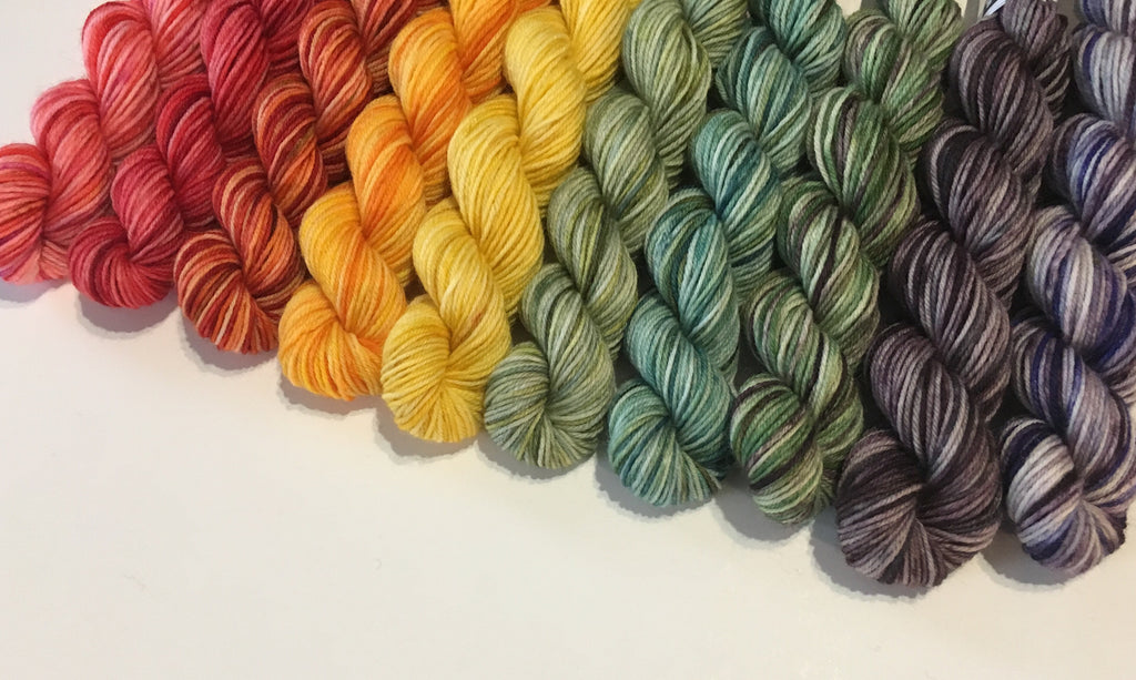 set of ten tonal 20g 4ply sock yarn mini skiens in a rainbow gradient