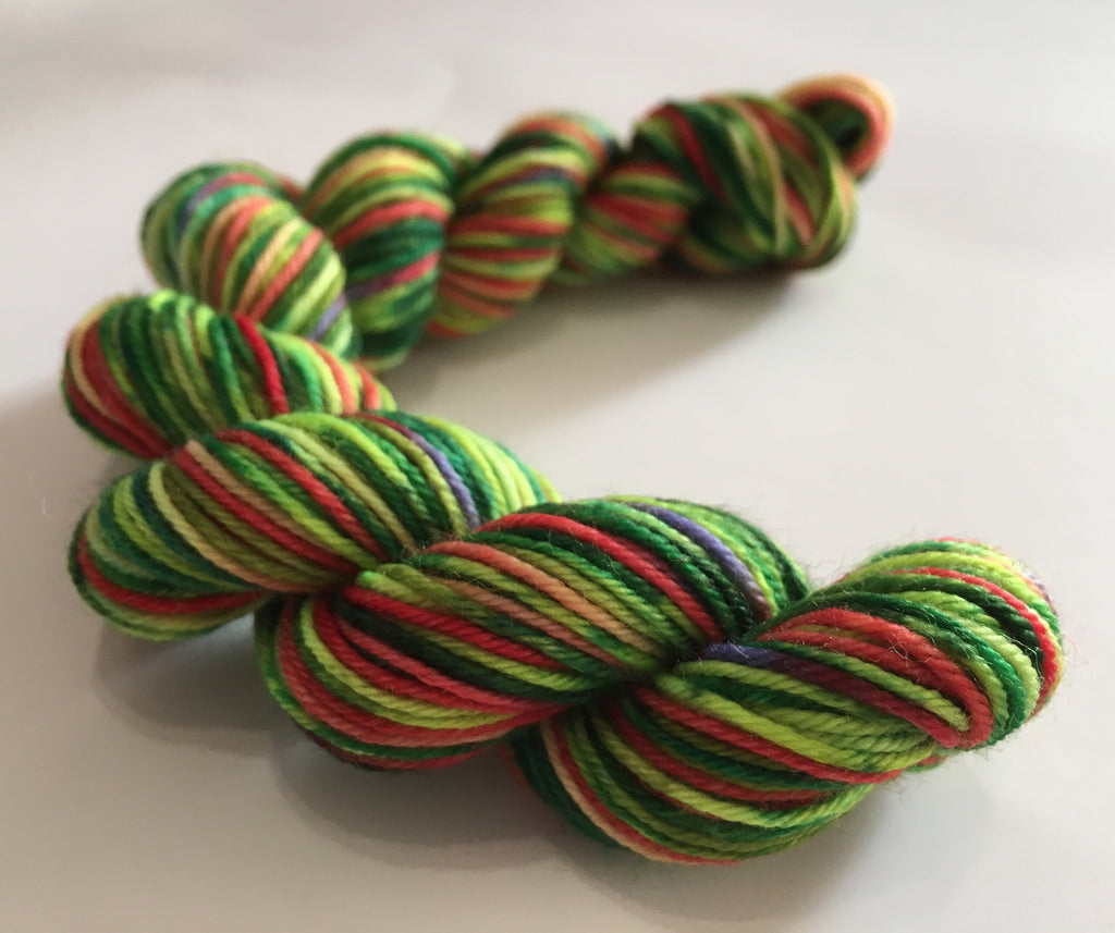 green and red uv reactive sock yarn inspired by the hungry caterpillar