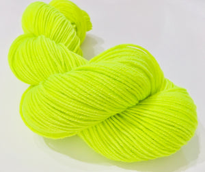 fluorescent neon yarn skein in highlighter yellow green for knitting and crochet