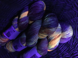 indie dyed uv reactive orange sock wool glowing under black light