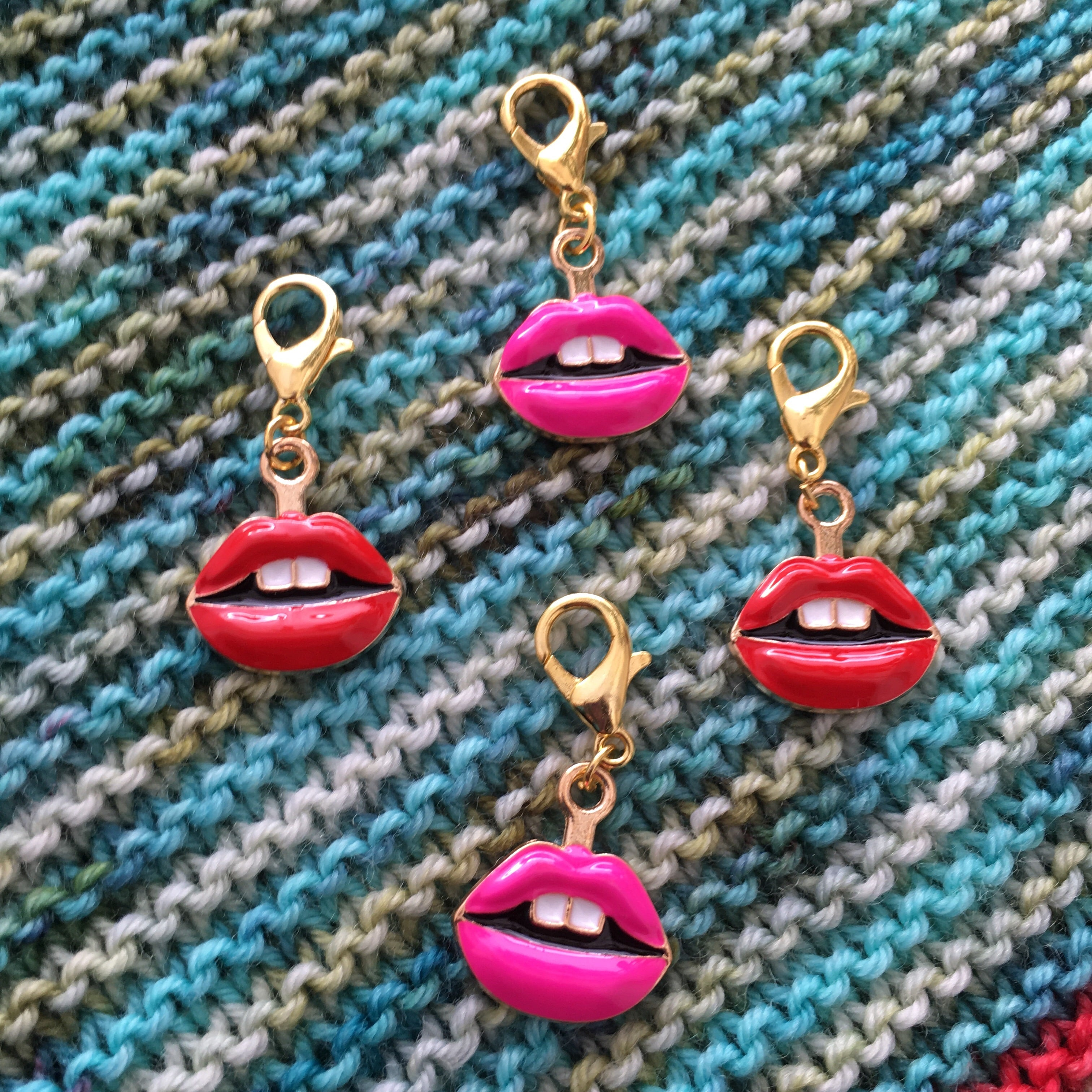 red and pink enamel lips charm on a hanging lbster clasp for knitting and crochet
