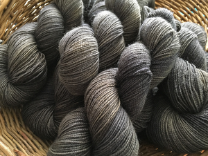 hand dyed tonal black and grey high twist bfl sock yarn skeins