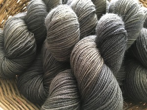 hand dyed tonal black and grey blue faced leicester yarn skeins