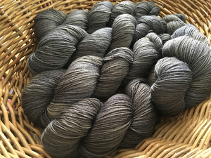tonal black hand dyed superwash meino sock yarn skeins