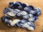 blue and white hand dyed merino yarn skein