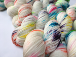 hand dyed rainbow speckled merino sock yarn skeins
