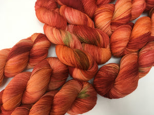 kettle dyed fall apple orange yarn skeins for knitting and crochet