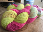 hand dyed pink and yellow merino wool sock yarn skein
