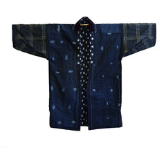An Indigo Dyed Work Coat: Kasuri Outside, Shibori Inside