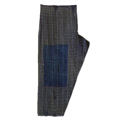 A Patched Cotton Trouser Leg: Stitched Closed
