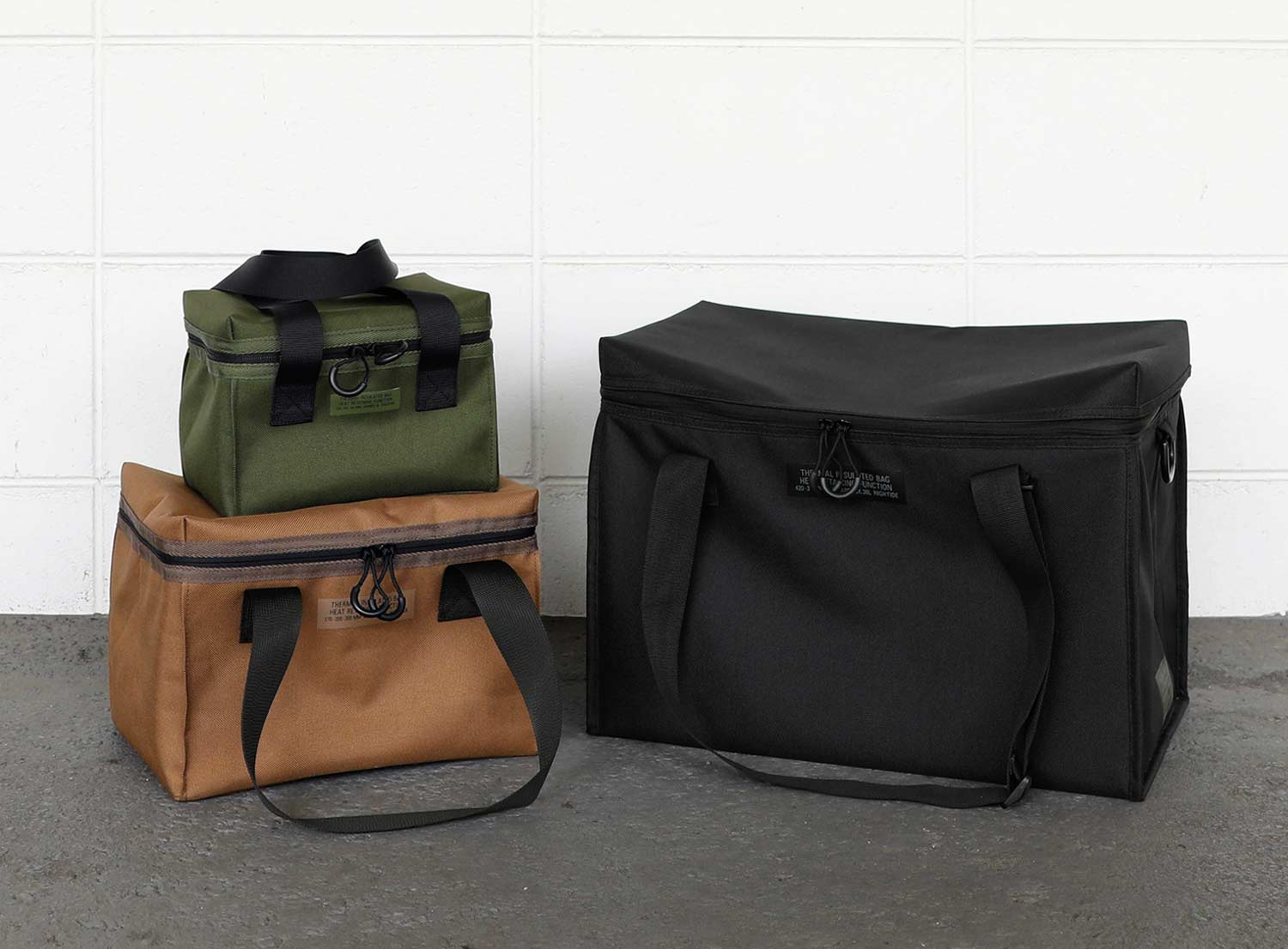 hightide cooler cargo bags in size small, medium and large in khaki, beige and black
